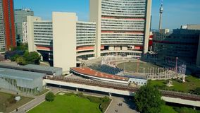 VIENNA, AUSTRIA - JULY 31, 2017. Aerial descending shot of United Nations UNO city buildings and the metro station. VIENNA, AUSTRIA - JULY 31, 2017. Aerial Stock Images