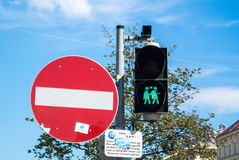 VIENNA, AUSTRIA - JULY 29, 2016: A close-up view of a green traffic light. With an image of two walking lesbian girls at the center of Vienna, Austria Stock Photos