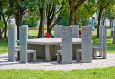 VIENNA, AUSTRIA - JULY 27, 2014:Marble table called Partner of all nations, memorial with ten marble chairs in Sigmund-Freud-Park Stock Images