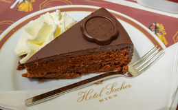 Free VIENNA, AUSTRIA - JUNE 01. 2016: Original Sacher Torte With Cream And Fork At Sacher Cafe Royalty Free Stock Image - 73205456