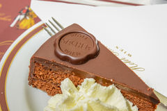 VIENNA, AUSTRIA - JUNE 01. 2016: Original Sacher Torte with crea Stock Photography