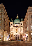 VIENNA, AUSTRIA - JUNE 5, 2015: The outside of Peterskirche St. Peters Church in Vienna at night from the Graben Royalty Free Stock Images