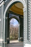 Vienna, Austria, March 2018. View of the garden through the arch of the old wooden arbor in the garden of Schonbrunn Palace, the royalty free stock photo