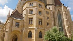 Gothic church building, Minoritenkirche close-up. Vienna, Austria 20 May 2018: gothic church building, Minoritenkirche close-up in Vienna, 20 May 2018 stock footage