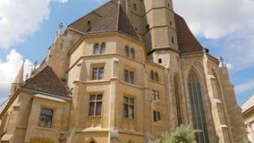 Minoritenkirche, gothic church building close-up. Vienna, Austria 20 May 2018: Minoritenkirche, gothic church building close-up in Vienna, 20 May 2018 stock video