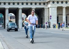 VIENNA, AUSTRIA - MAY 26: Modern city transport - People riding the streets on rented electric scooters by Bird in Vienna, Austria. On May 26, 2019 stock photo