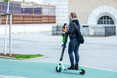 VIENNA, AUSTRIA - MAY 26: Modern city transport - People riding the streets on rented electric scooters by Lime S in Vienna,. Austria, on May 26, 2019 stock image