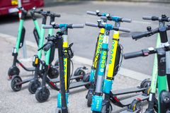 VIENNA, AUSTRIA - MAY 26: Modern city transport - rent electric scooters by Wind, Bird, Tier and Flash is parked on the street of. The city. in Vienna, Austria stock images