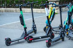 VIENNA, AUSTRIA - MAY 26: Modern city transport - rent electric scooters by Wind, Bird, Tier and Flash is parked on the street of. The city. in Vienna, Austria royalty free stock images