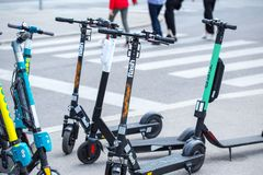 VIENNA, AUSTRIA - MAY 26: Modern city transport - rent electric scooters by Wind, Bird, Tier and Flash is parked on the street of. The city. in Vienna, Austria stock image