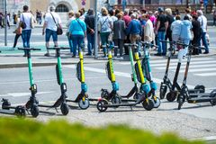 VIENNA, AUSTRIA - MAY 26: Modern city transport - rent electric scooters by Wind, Bird, Tier and Flash is parked on the street of. The city. in Vienna, Austria royalty free stock image