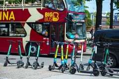 VIENNA, AUSTRIA - MAY 26: Modern city transport - rent electric scooters by Wind, Bird, Tier and Flash is parked on the street of. The city. in Vienna, Austria royalty free stock photography