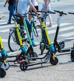 VIENNA, AUSTRIA - MAY 26: Modern city transport - rent electric scooters by Wind, Bird, Tier and Flash is parked on the street of. The city. in Vienna, Austria stock photo