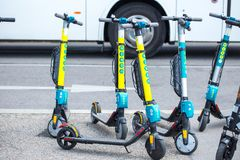 VIENNA, AUSTRIA - MAY 26: Modern city transport - rent electric scooters by Wind, Tier and Flash is parked on the street of the. City in Vienna, Austria, on May royalty free stock photo