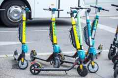 VIENNA, AUSTRIA - MAY 26: Modern city transport - rent electric scooters by Wind, Tier and Flash is parked on the street of the. City in Vienna, Austria, on May royalty free stock image
