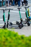 VIENNA, AUSTRIA - MAY 26: Modern city transport - rent electric scooters by Wind, Tier is parked on the street of the city in. Vienna, Austria, on May 26, 2019 royalty free stock photo