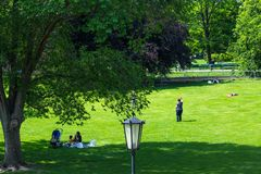 VIENNA, AUSTRIA - MAY 26: People are resting and relaxing in popular public Burggarten park in warm sunny day in Vienna, Austria,. On May 26, 2019, beautiful royalty free stock images