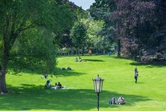 VIENNA, AUSTRIA - MAY 26: People are resting and relaxing in popular public Burggarten park in warm sunny day in Vienna, Austria,. On May 26, 2019, beautiful stock image