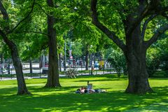 VIENNA, AUSTRIA - MAY 26: People are resting and relaxing in public Rathauspark park in warm sunny day in Vienna, Austria, on May. 26, 2019, beautiful, city royalty free stock images