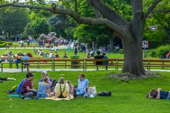 VIENNA, AUSTRIA - MAY 26: People are resting and relaxing in public Stadtpark park in warm sunny day in Vienna, Austria, on May 26. 2019, beautiful, city stock photography