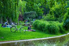 VIENNA, AUSTRIA - MAY 26: People are resting and relaxing in public Stadtpark park in warm sunny day in Vienna, Austria, on May 26. 2019, beautiful, city royalty free stock photography