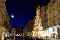 VIENNA, AUSTRIA - MAY 17, 2016: Photo view. On memorial plague column pestsaule and tourists on graben street at night with people Stock Image