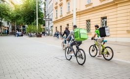 Uber eats food delivery. Vienna Austria May.25 2018, Uber Eats is an International food delivery company from U.S, Cyclist caring backpacks royalty free stock photos