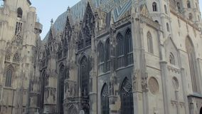 Vienna, Austria - MAY, 2018: vertical panorama of architecture of gothic St Stephen Cathedral. Vienna, Austria - MAY, 2018: vertical panorama of beautiful stock footage