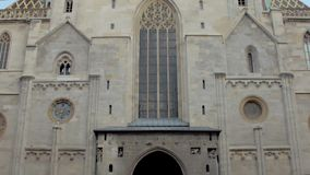 Vienna, Austria - MAY, 2018:vertical panoramic view from walking people to facade of St. Stephens Cathedral stock video