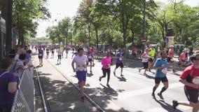 Spectators watch athletes marathon runners stock video