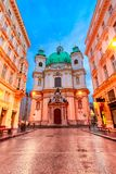 Vienna, Austria: Night view of the St. Peter Church, Peterskirche, a Baroque Roman Catholic parish church. At the traditional pedestrian zone Graben royalty free stock image