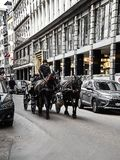 Poeple are visiting the city on a horse-drawn carriage stock images