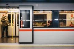 Underground train with open doors at a station platform in Vienna, Austria. Vienna, Austria - November 25, 2018: Underground train with open doors at a station royalty free stock images