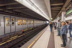 VIENNA, AUSTRIA - OCTOBER 10, 2016: Langenfeldgasse Train Station with People in Vienna, Austria Royalty Free Stock Photo