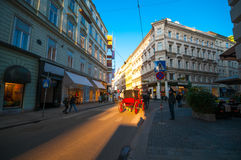 VIENNA, AUSTRIA - OCTOBER 12, 2015: Street in the old town at su Stock Photo