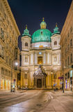 Vienna, Austria. The outside of the Catholic Church of St. Peter in Vienna at night from the Graben Stock Images