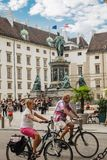 Vienna, Austria - September , 15, 2019: Biker couple in front of the monument to Francis II in a courtyard surrounded of royalty free stock photos