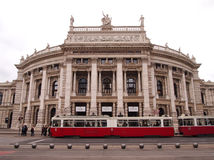 Vienna, Austria - September 26, 2014: Historic Burgtheater (Court Theatre) at the famous Wiener Ringstrasse with people and the tr Stock Photo