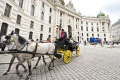 Horse-drawn carriage in Vienna Stock Images