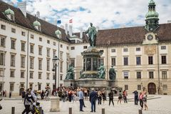 Vienna, Austria - September , 15, 2019: Monument to Francis II in a courtyard surrounded of tourists at the Hofburg royalty free stock image