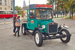 Vienna, Austria - September 22, 2014: Tourists near movable gingerbread and candy shop in the form of a vintage car on Royalty Free Stock Photos
