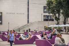 Vienna, Austria - September , 15, 2019: nTourists, young couples, teenagers and families relaxing in the benches of the stock images