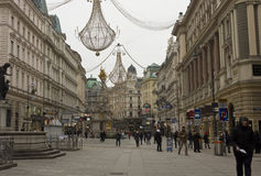 Vienna city centre at day time in winter season. VIENNA, AUSTRIA - JANUARY 3 2016: Vienna city centre at day time in winter season: Graben street full of people Stock Image