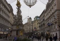 Vienna city centre at day time in winter season. VIENNA, AUSTRIA - JANUARY 3 2016: Vienna city centre at day time in winter season: Graben street full of people Royalty Free Stock Photo