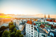 Vienna cityscape in Austria. Panoramic cityscape view on Vienna city with Mariahilfer church towers on the sunset in Austria stock photos