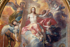 Vienna - Detail of Resurrected Jesus in heaven on side altar of baroque st. Peter church Stock Images