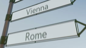 Vienna direction sign on road signpost with European cities captions. 4K conceptual clip. Vienna direction sign on road signpost with European cities captions stock footage