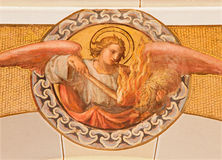 Vienna - The fresco of angel with the fire by Josef Kastner the younger from 20. cent in the church Muttergotteskirche. Stock Image