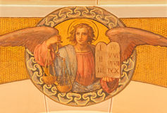 Vienna - The fresco of angel with the fire by Josef Kastner the younger from 20. cent in the church Muttergotteskirche. Stock Images