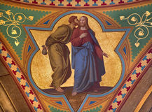 Vienna - Fresco of Judas betray Jesus with the kiss scene in side nave of Altlerchenfelder church Stock Photos
